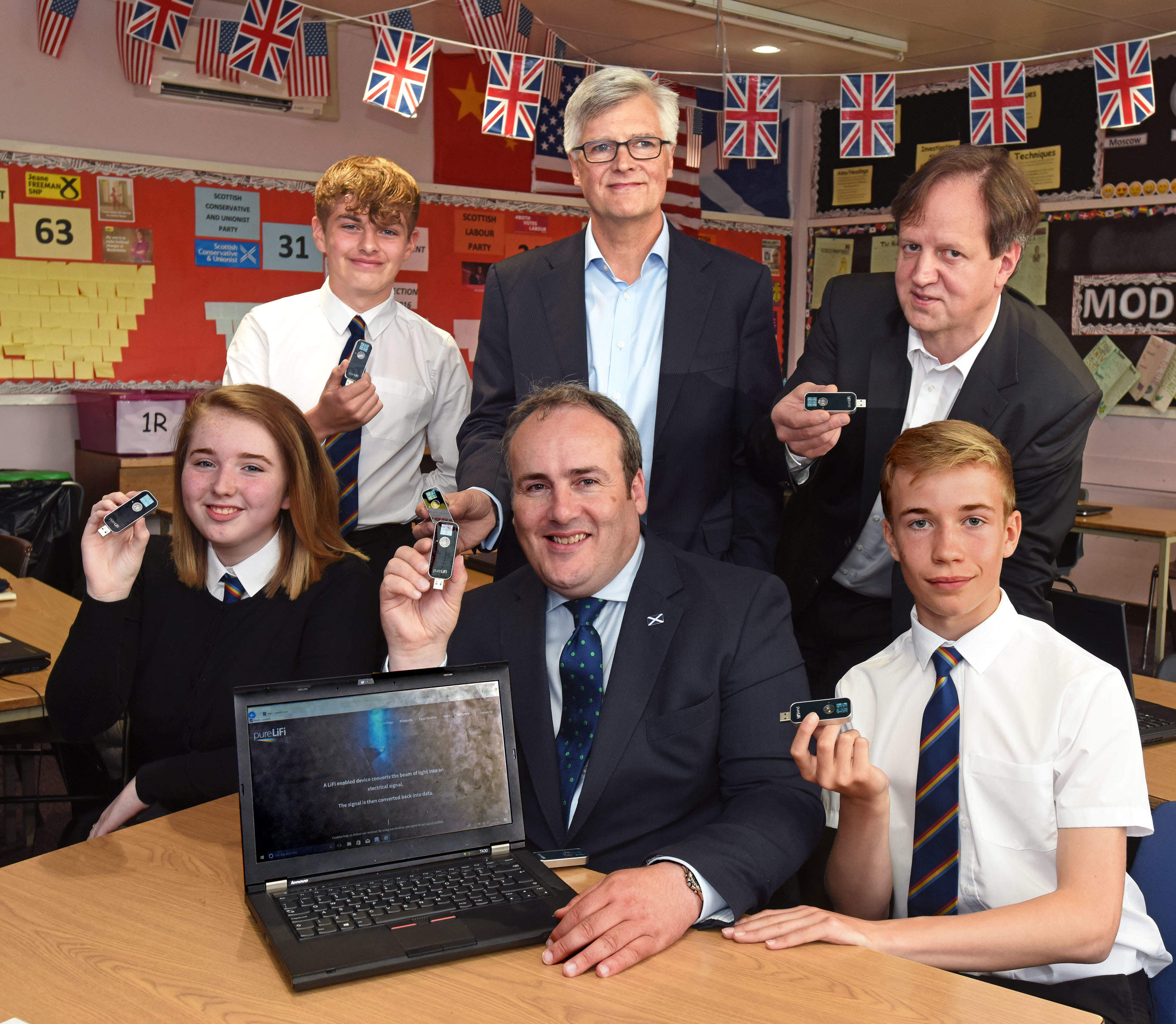 Paul Wheelhouse (MSP) along with Alistair Banham and Harald Haas of pureLiFi and students at Kyle Academy 2