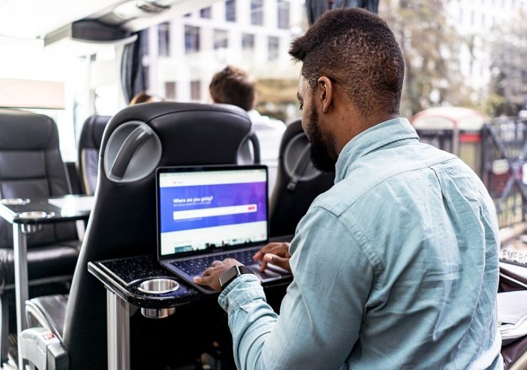 Passenger using Zeelo AI-powered coach service