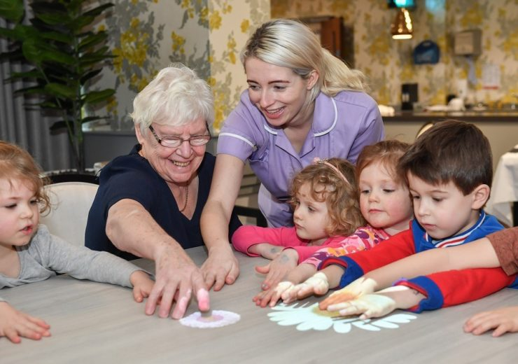 School children and care home residents play a game on the Magic Table