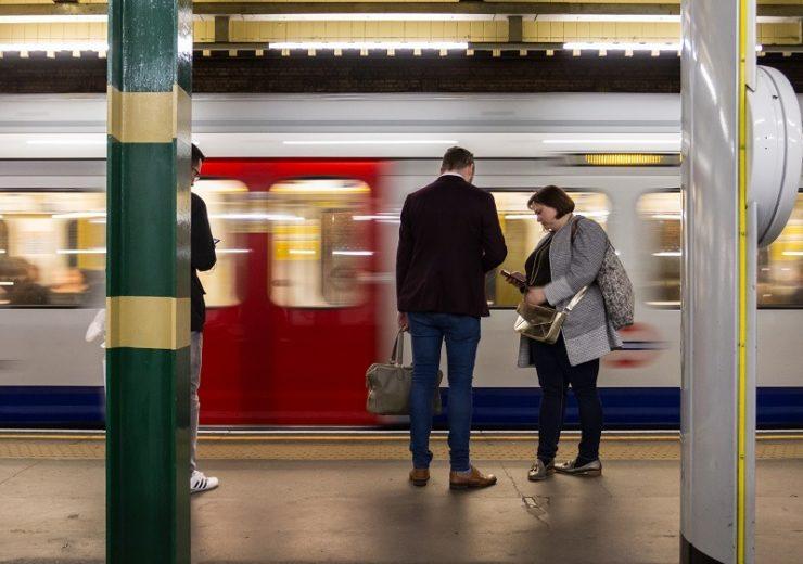 Passengers wait on a London Underground platform (Credit: Pexels)