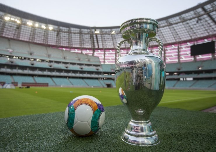 UEFA Euro 2020 football and cup at one of the 12 host stadiums (Credit: UEFA)